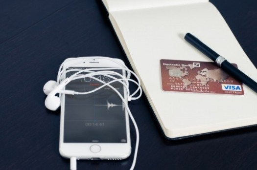mobile-phone-and-credit-card-with-notebook-and-pen-on-table