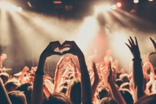 people-enjoying-rock-concert-with-heartshape-hand-gesture