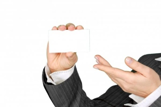 businesswoman-presenting-blank-card